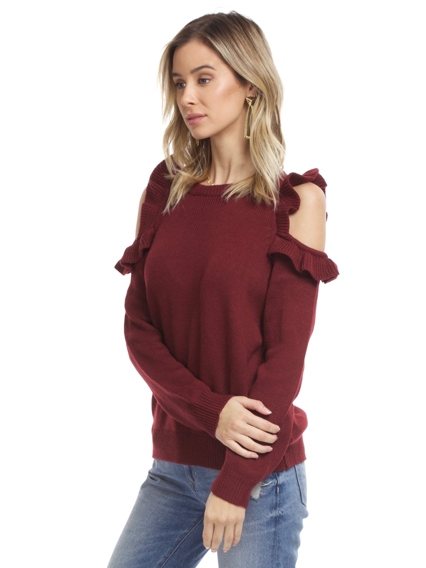 Women wearing a sweater rental from FashionPass called Harmony Cold Shoulder Sweater