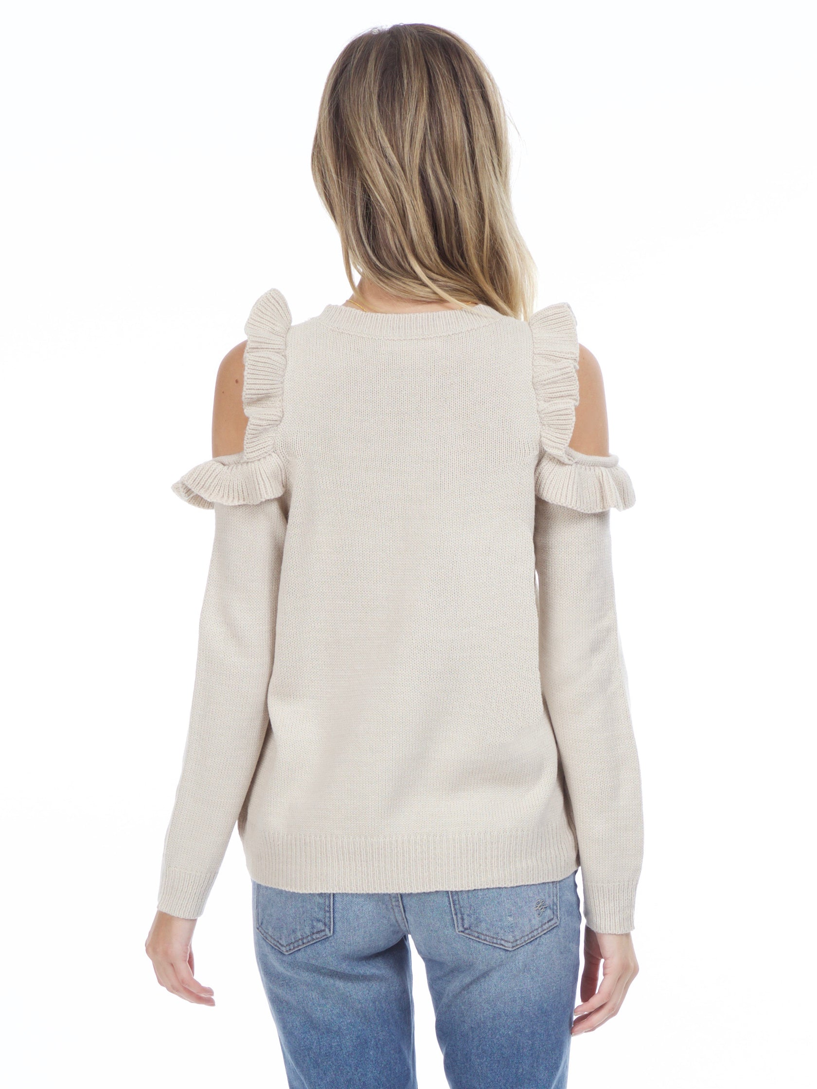 Women outfit in a sweater rental from FashionPass called Harmony Cold Shoulder Sweater