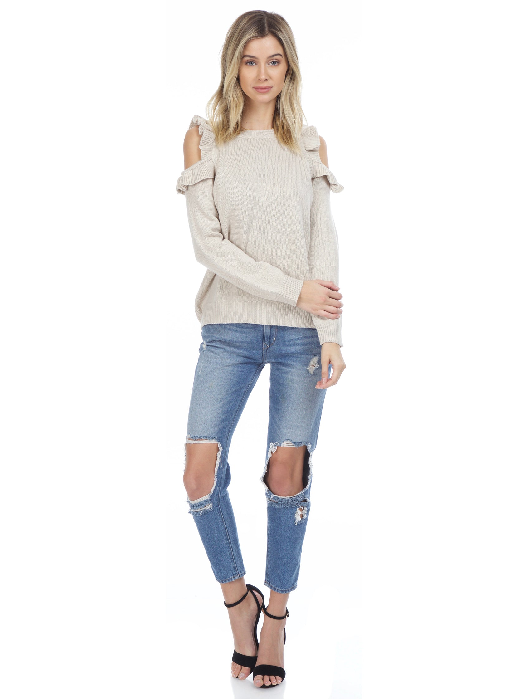 Girl wearing a sweater rental from FashionPass called Harmony Cold Shoulder Sweater