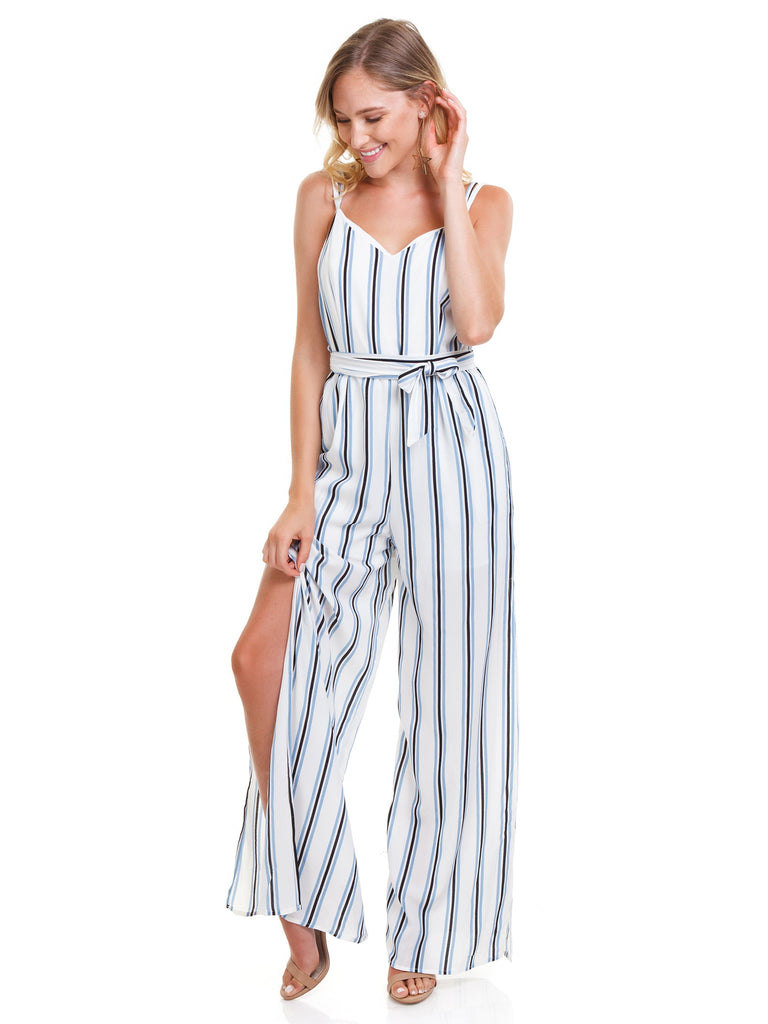 Girl wearing a jumpsuit rental from Strut & Bolt called Flutter Sleeve Wide Leg Jumpsuit