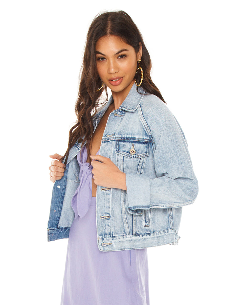 Woman wearing a jacket rental from PISTOLA called Brando Puff Denim Jacket