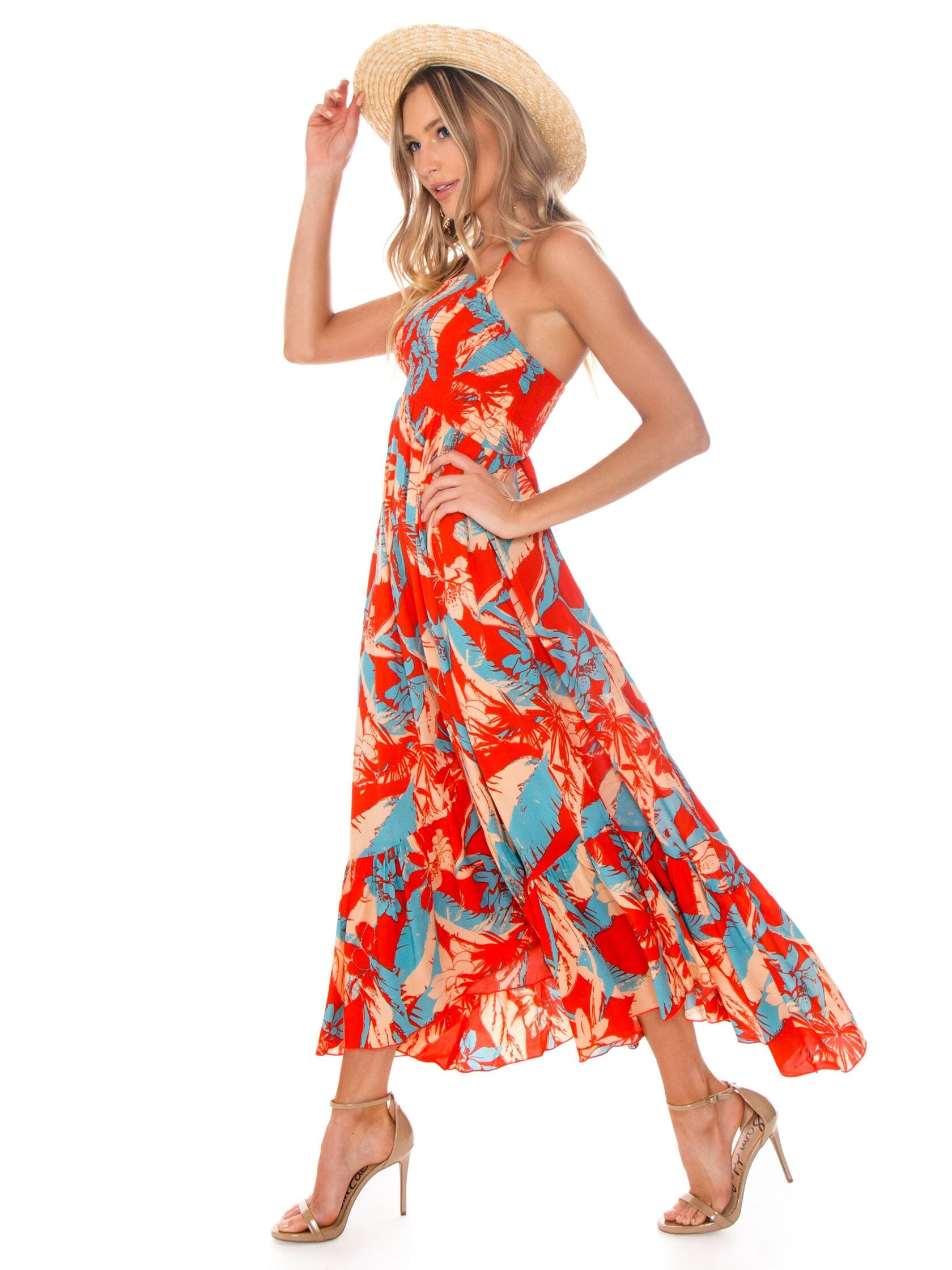 Woman wearing a dress rental from Free People called Heat Wave Printed Maxi