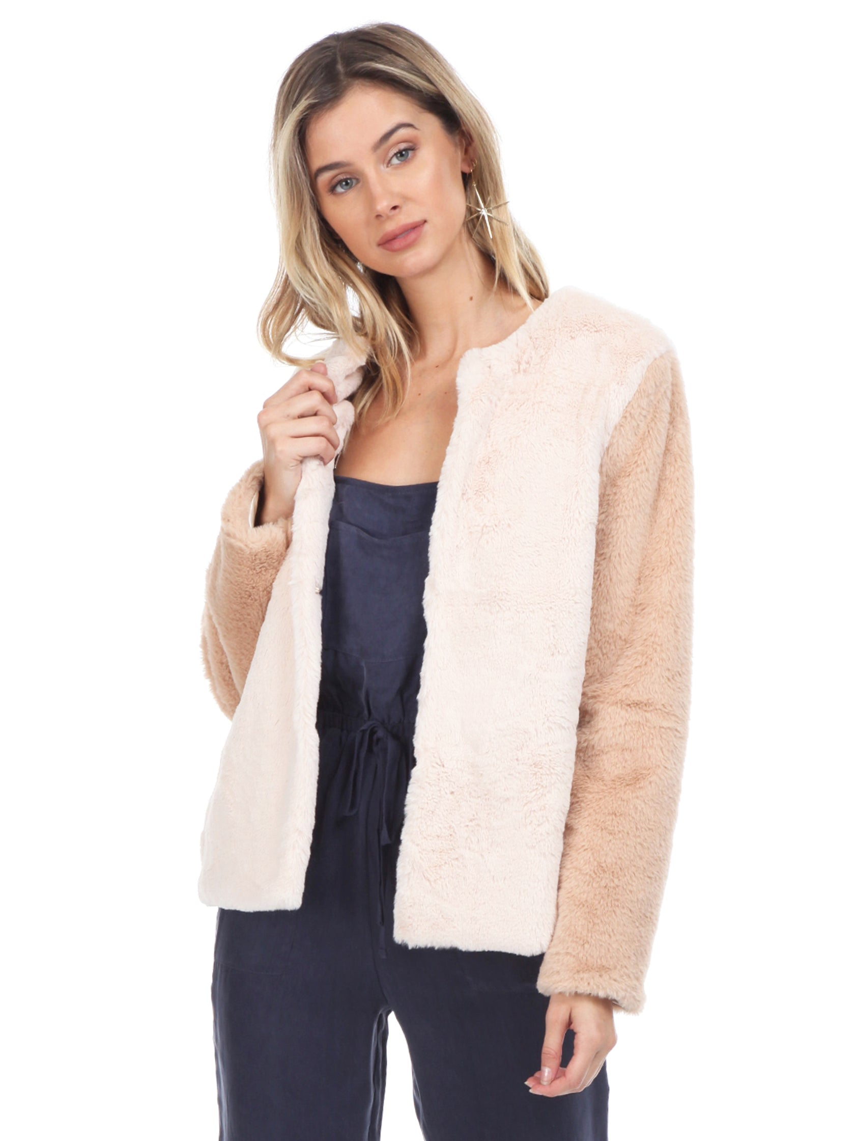 Woman wearing a jacket rental from WYLDR called Heidi Faux Fur Jacket
