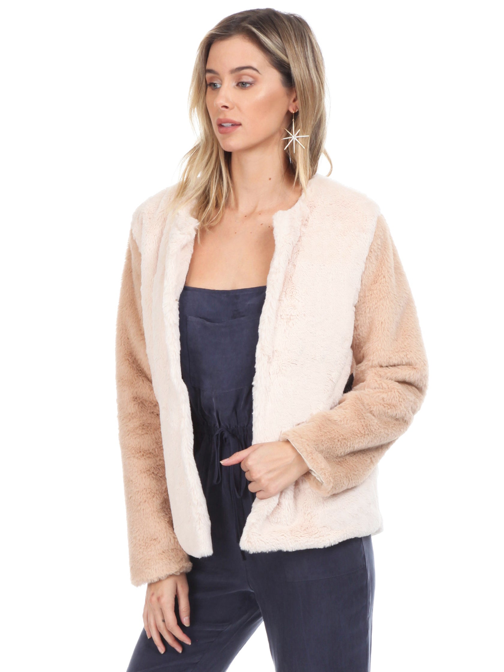 Women wearing a jacket rental from WYLDR called Heidi Faux Fur Jacket
