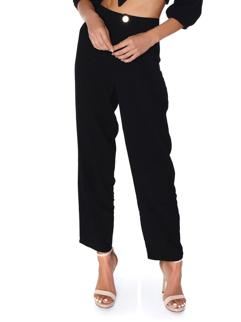 Women wearing a pants rental from Show Me Your Mumu called Campbell High Slit Pants