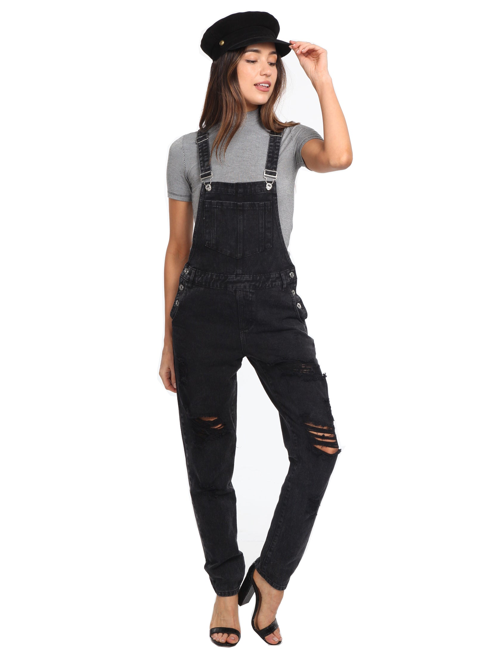 Woman wearing a jumpsuit rental from FashionPass called Here For A Good Time Overalls