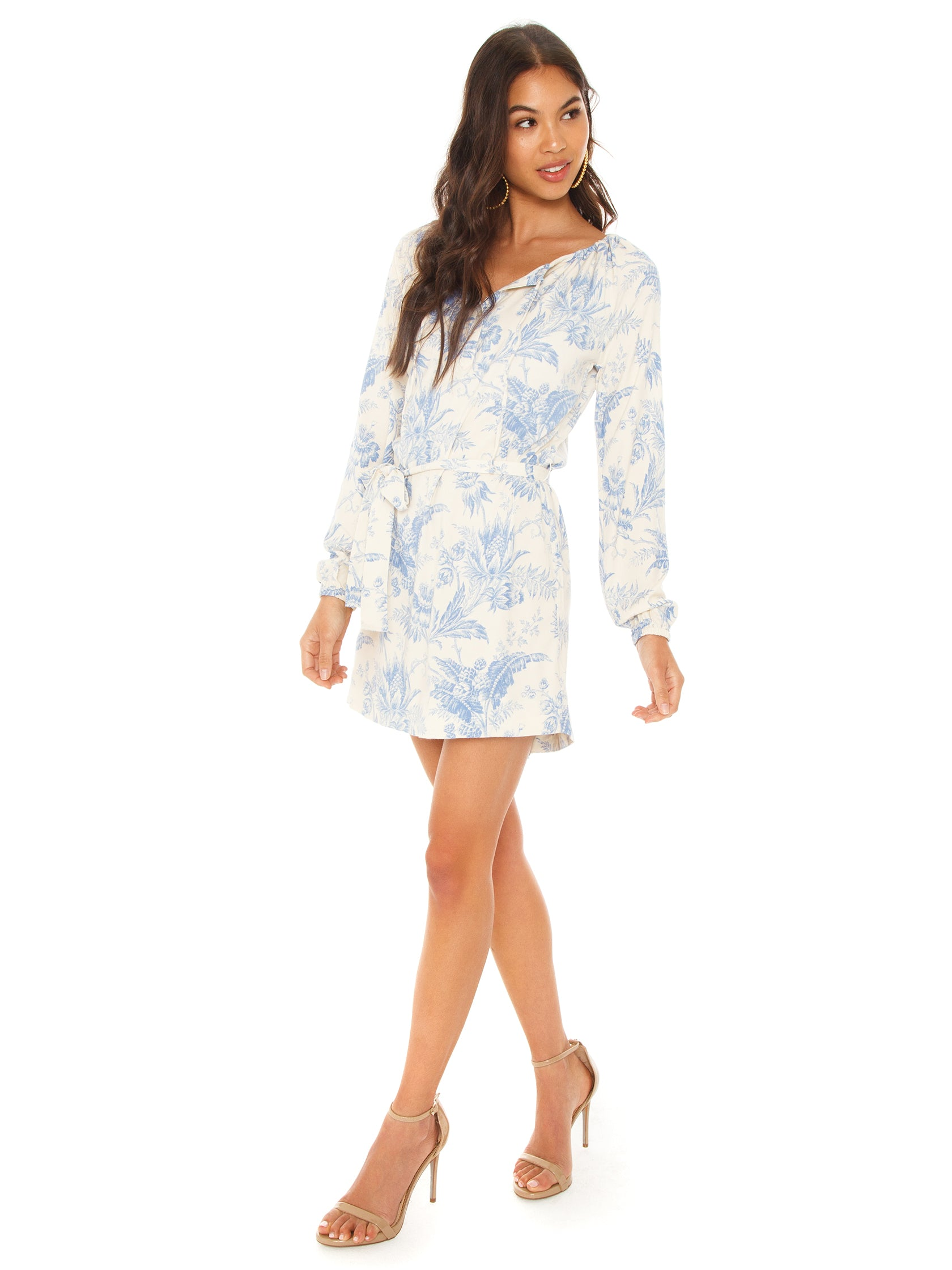 Woman wearing a dress rental from Chaser called Heirloom Long Sleeve Raglan Shirttail Dress