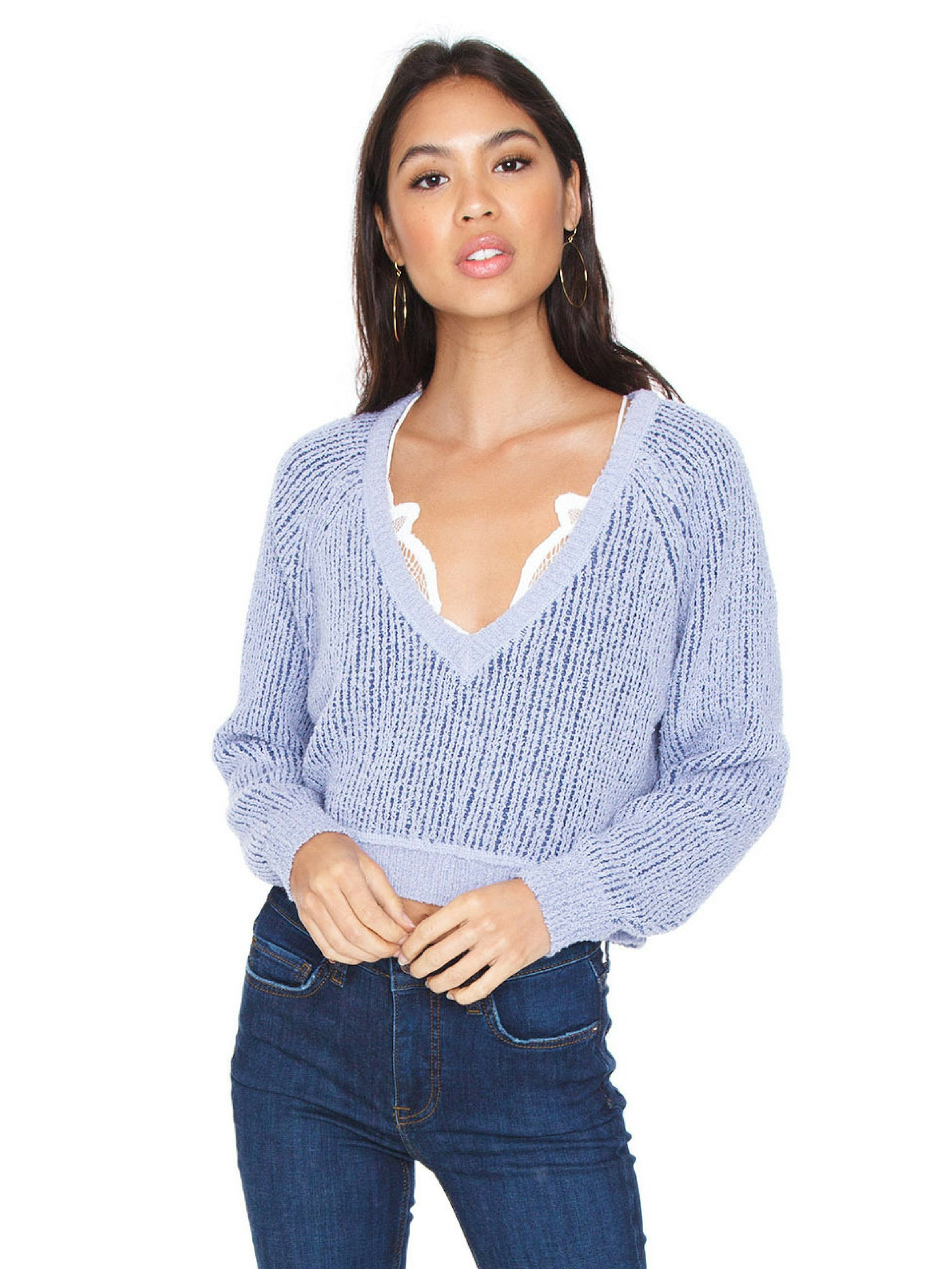 Woman wearing a sweater rental from Free People called V Neck Sweater