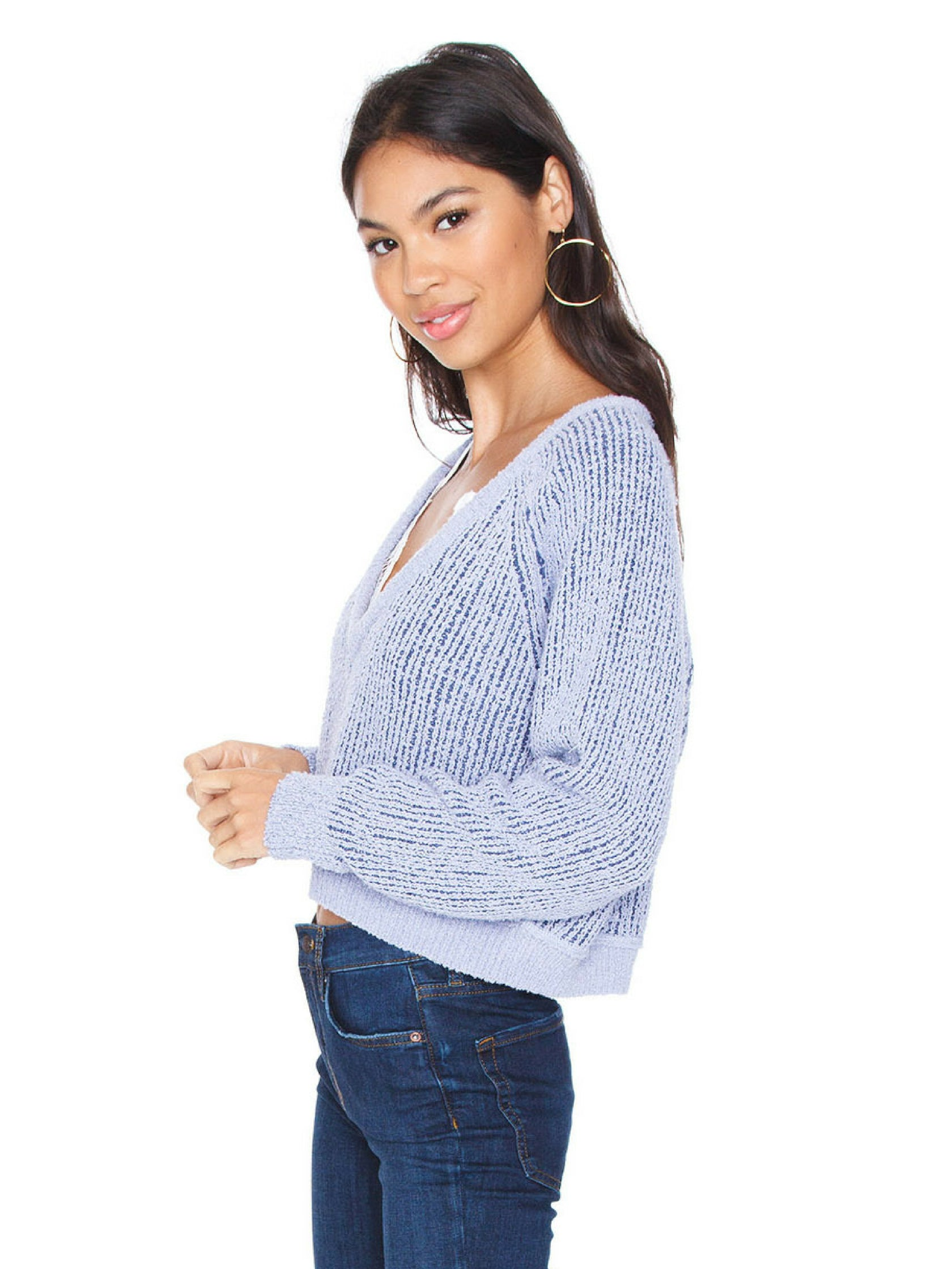 Women wearing a sweater rental from Free People called V Neck Sweater