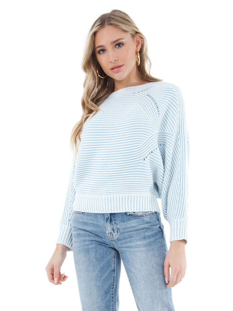 Women wearing a sweater rental from Line & Dot called Chiara Ruffled Top