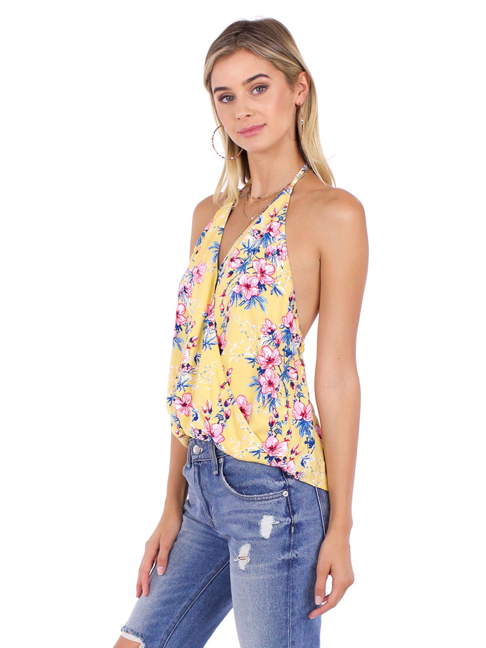 Women wearing a top rental from FashionPass called Honey Floral Top