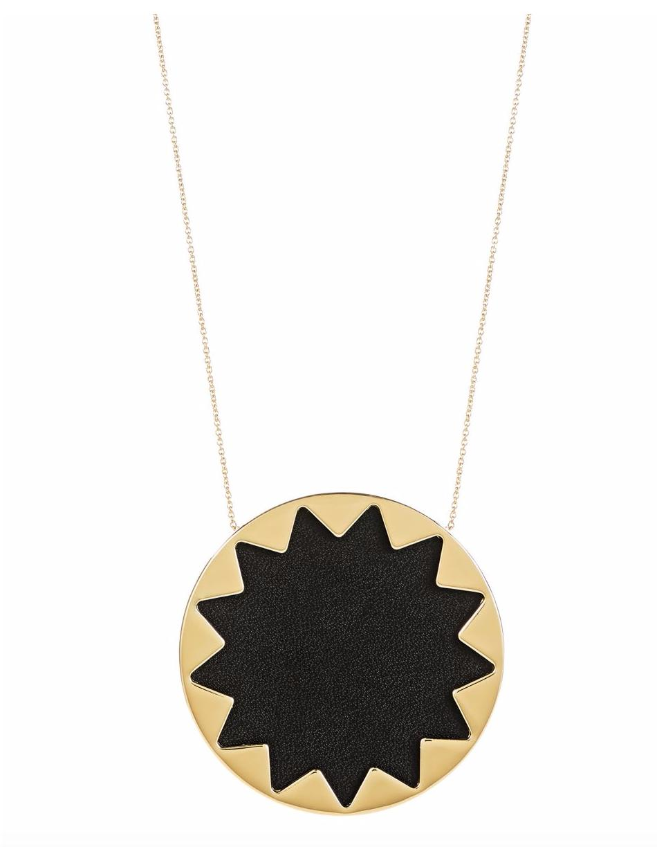Women outfit in a necklace rental from House of Harlow 1960 called Black Large Sunburst Necklace