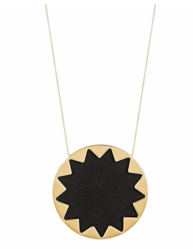 Women wearing a necklace rental from House of Harlow 1960 called Black Large Sunburst Necklace