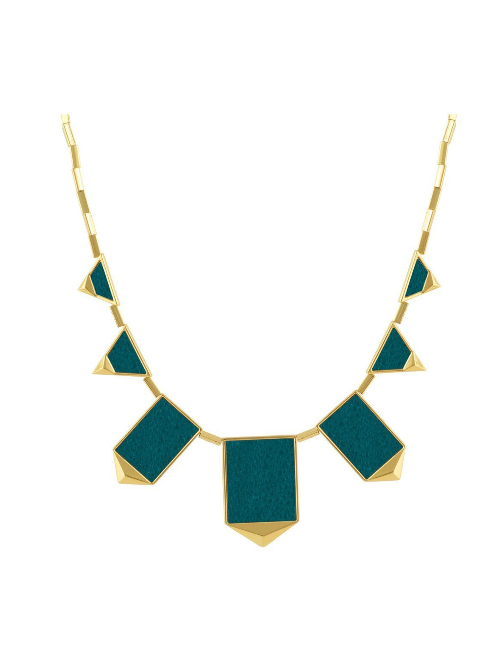 Girl wearing a necklace rental from House of Harlow 1960 called Classic Station Pyramid Necklace