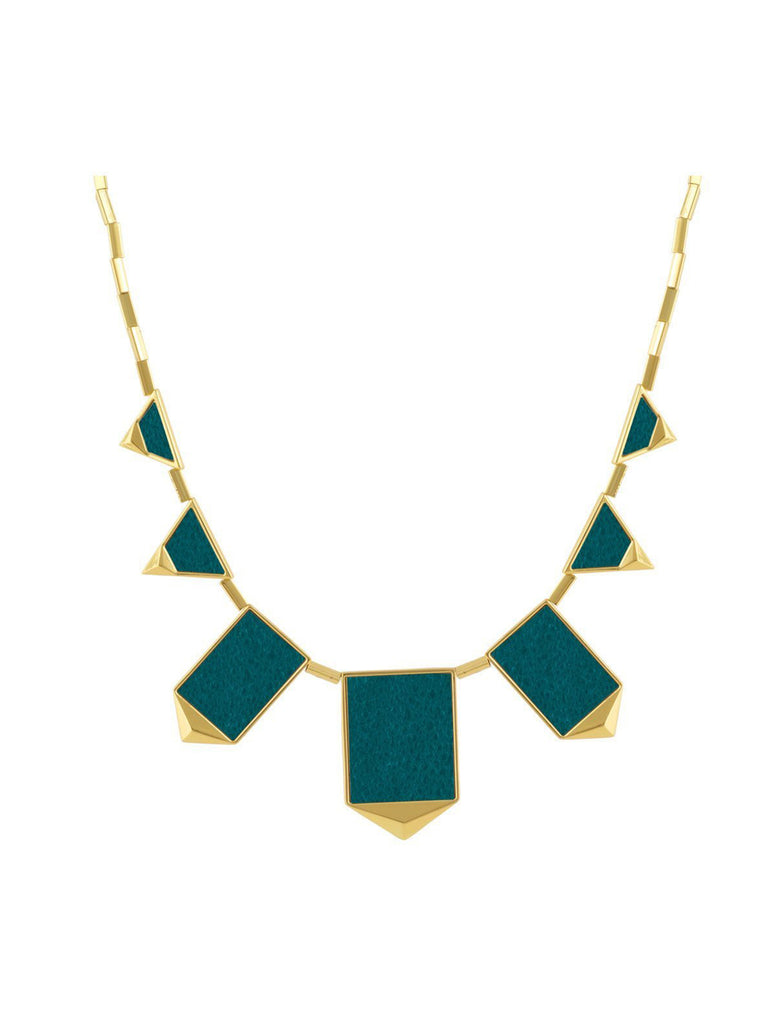 Women wearing a necklace rental from House of Harlow 1960 called Classic Station Pyramid Necklace