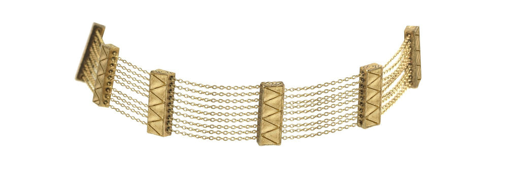 Woman wearing a necklace rental from House of Harlow 1960 called Nelli Cuff Bracelet