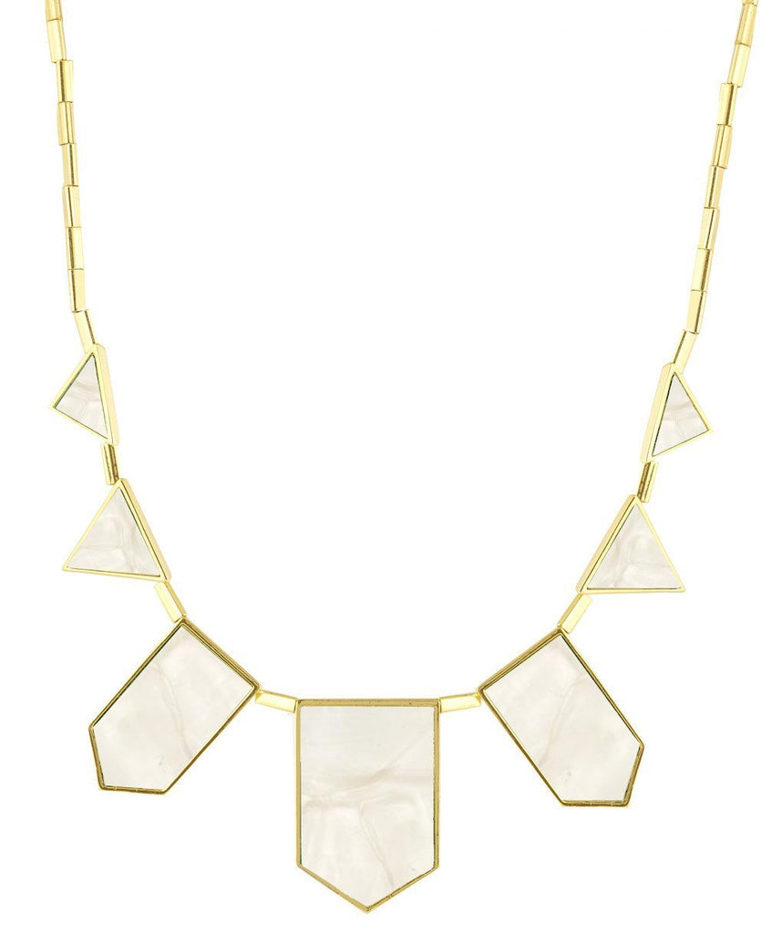 Girl wearing a necklace rental from House of Harlow 1960 called Golden Pendant Necklace