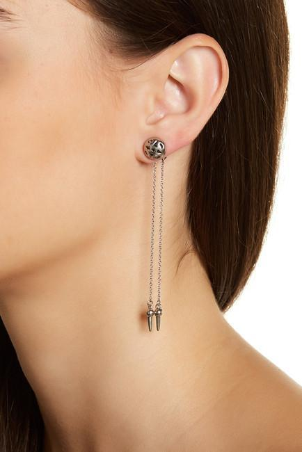Women wearing a earrings rental from House of Harlow 1960 called Silver Ayita Drop Ear Jacket