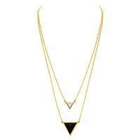 Women wearing a necklace rental from House of Harlow 1960 called Golden Pendant Necklace