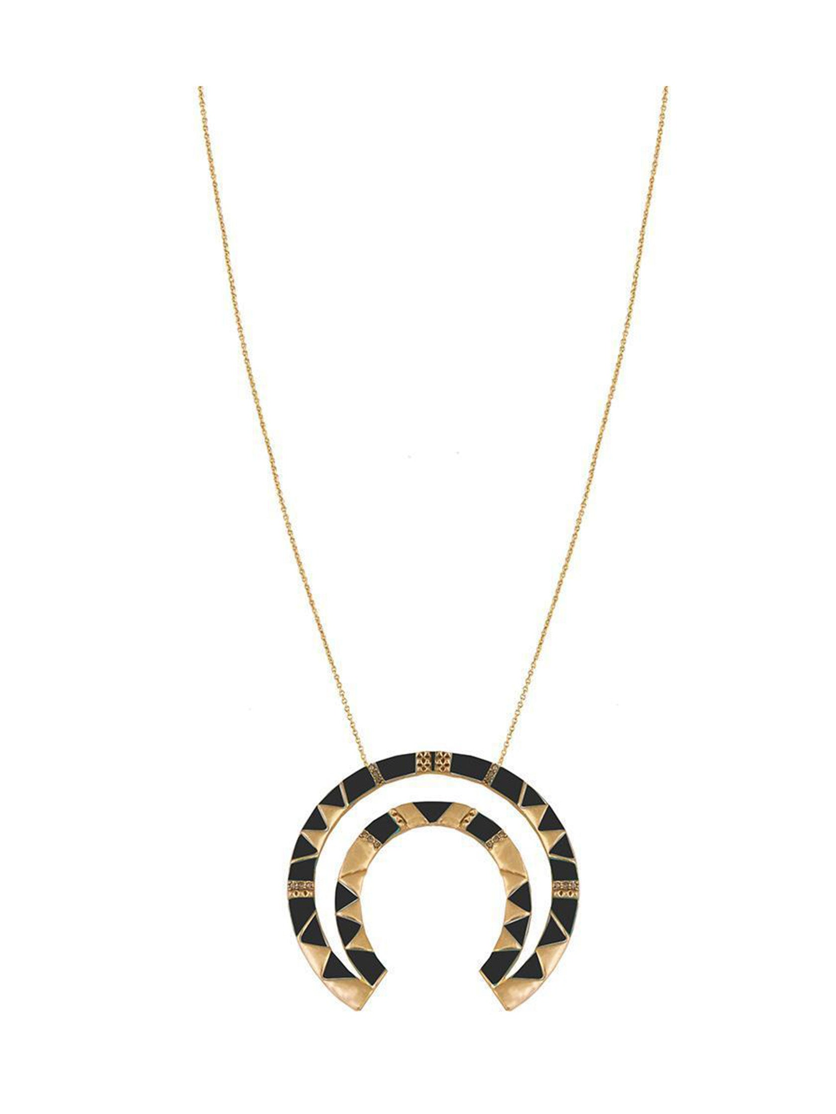 Girl wearing a necklace rental from House of Harlow 1960 called House Of Harlow Curve Aztec Pendant Necklace