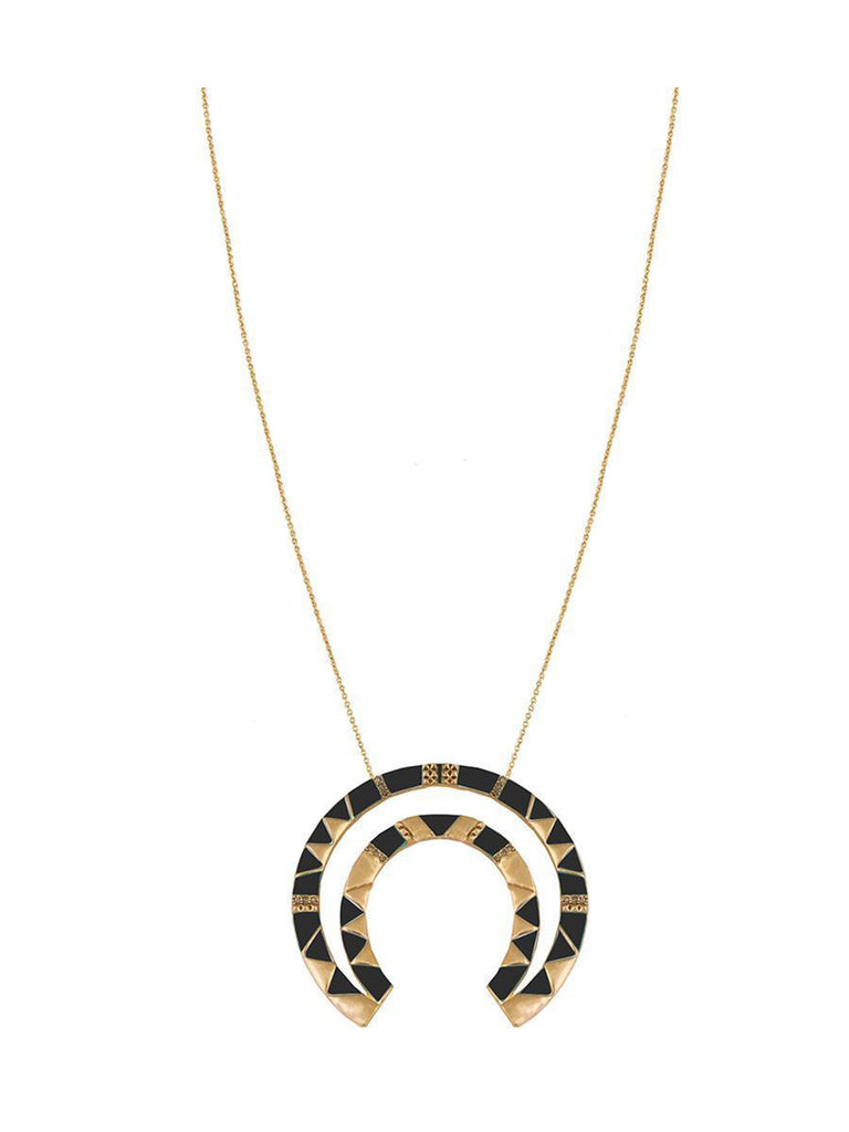 Women wearing a necklace rental from House of Harlow 1960 called House Of Harlow Curve Aztec Pendant Necklace