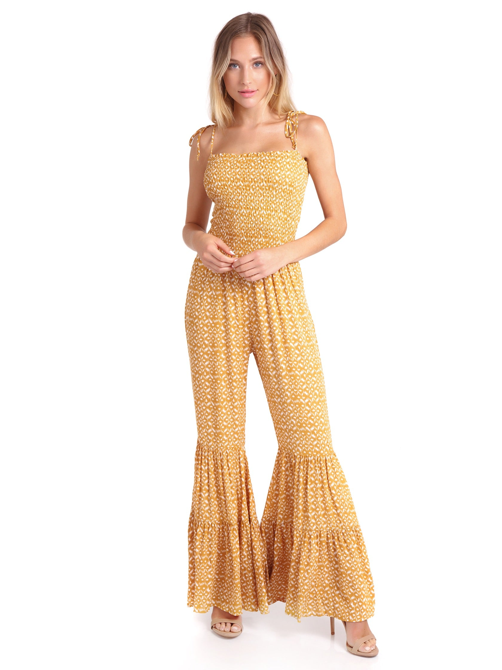 Woman wearing a jumpsuit rental from FashionPass called Indian Summer Jumpsuit