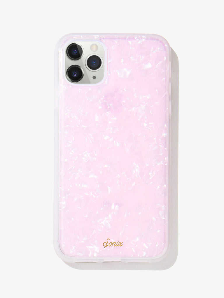 Women wearing a phone case rental from Sonix called Pink Pearl Tort Iphone 11 Pro Max/xs Max