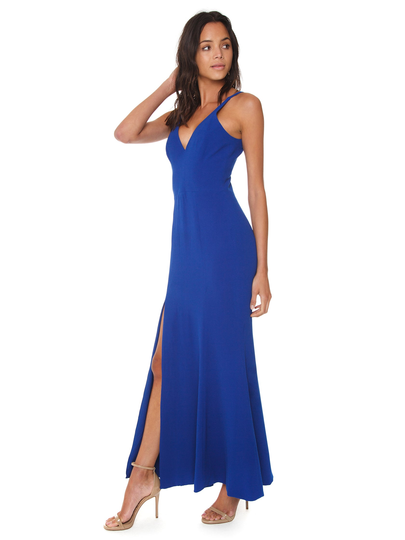Woman wearing a dress rental from Dress the Population called Iris Crepe Side Slit Gown