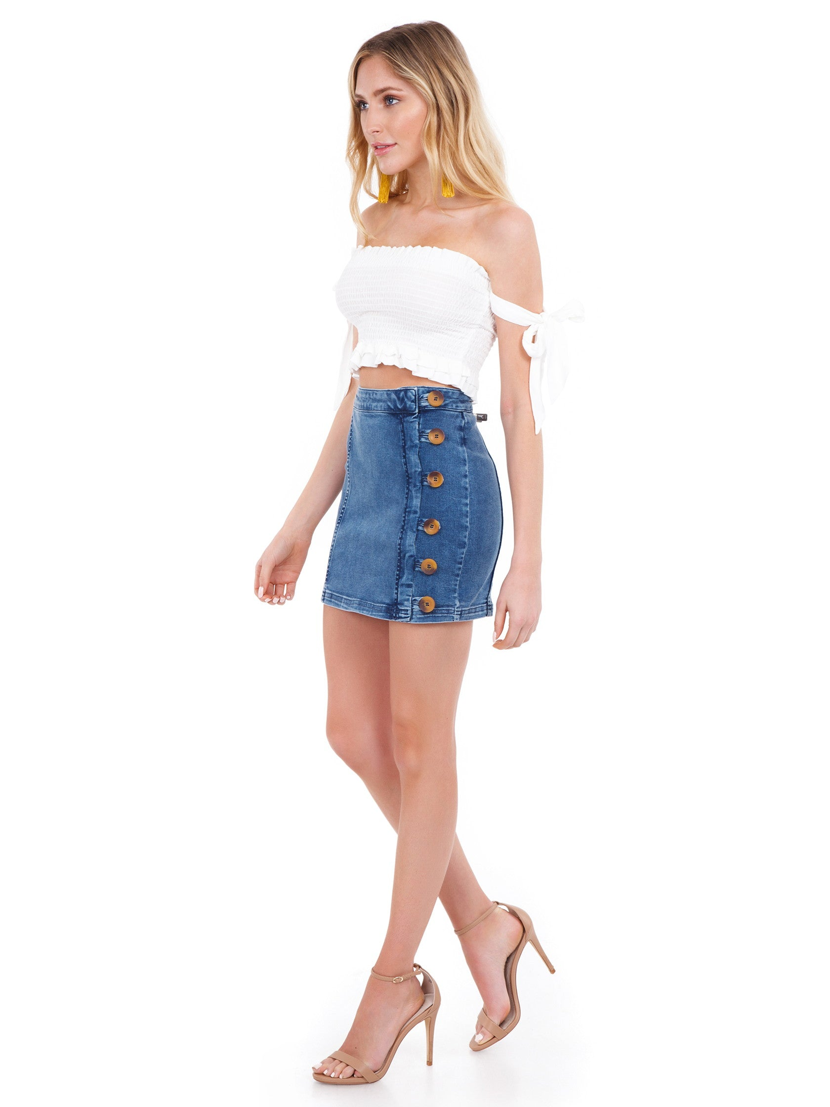 Woman wearing a skirt rental from Free People called Little Daisies Denim Mini Skirt