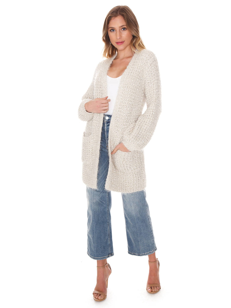Girl wearing a cardigan rental from BB Dakota called Warm Thoughts Wubby Jacket
