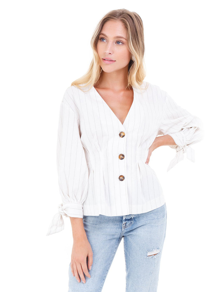 Woman wearing a top rental from FashionPass called Ruffle Sleeve Striped Sweater