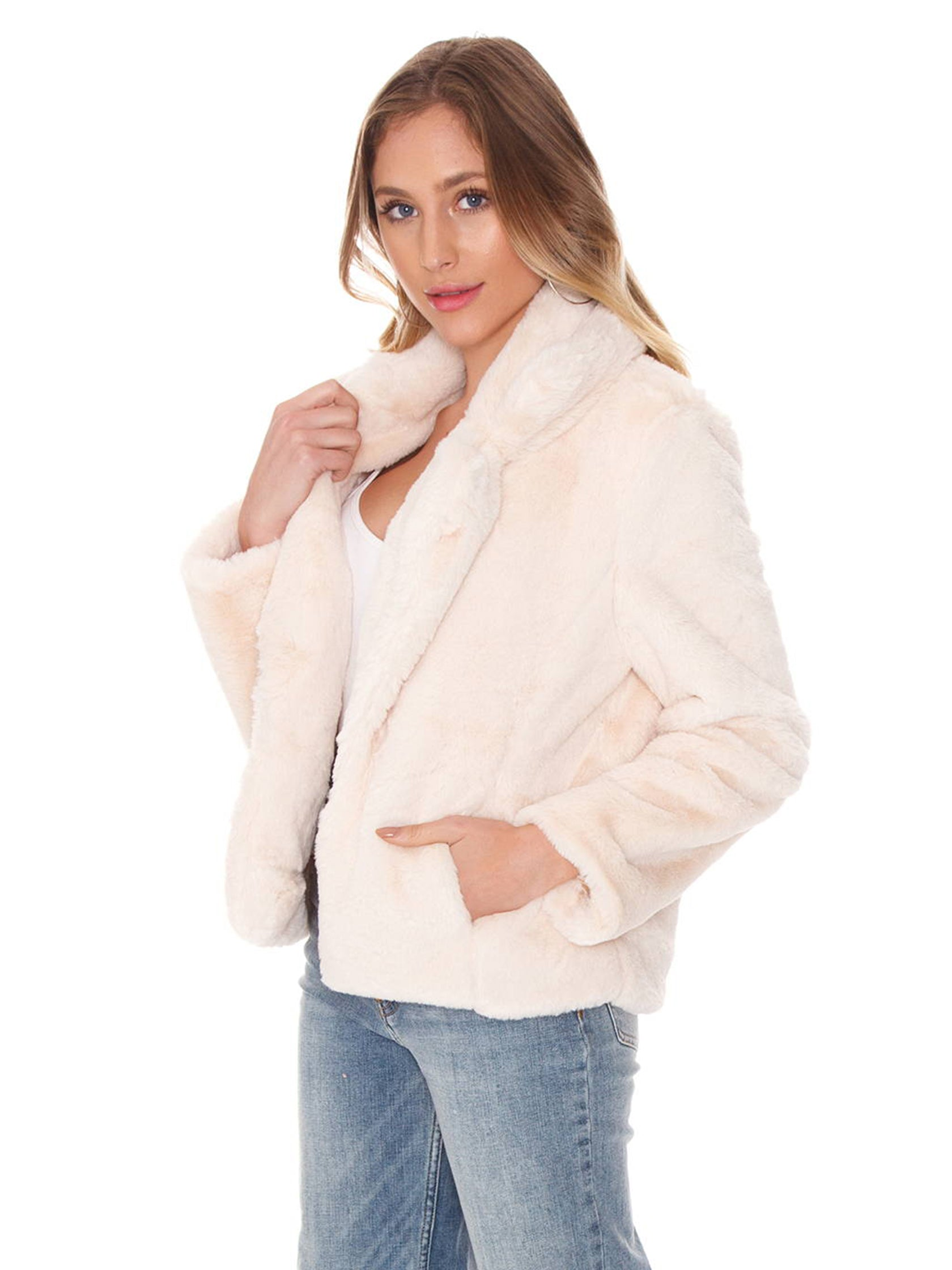 Women wearing a jacket rental from FashionPass called Izzy Faux Fur Jacket