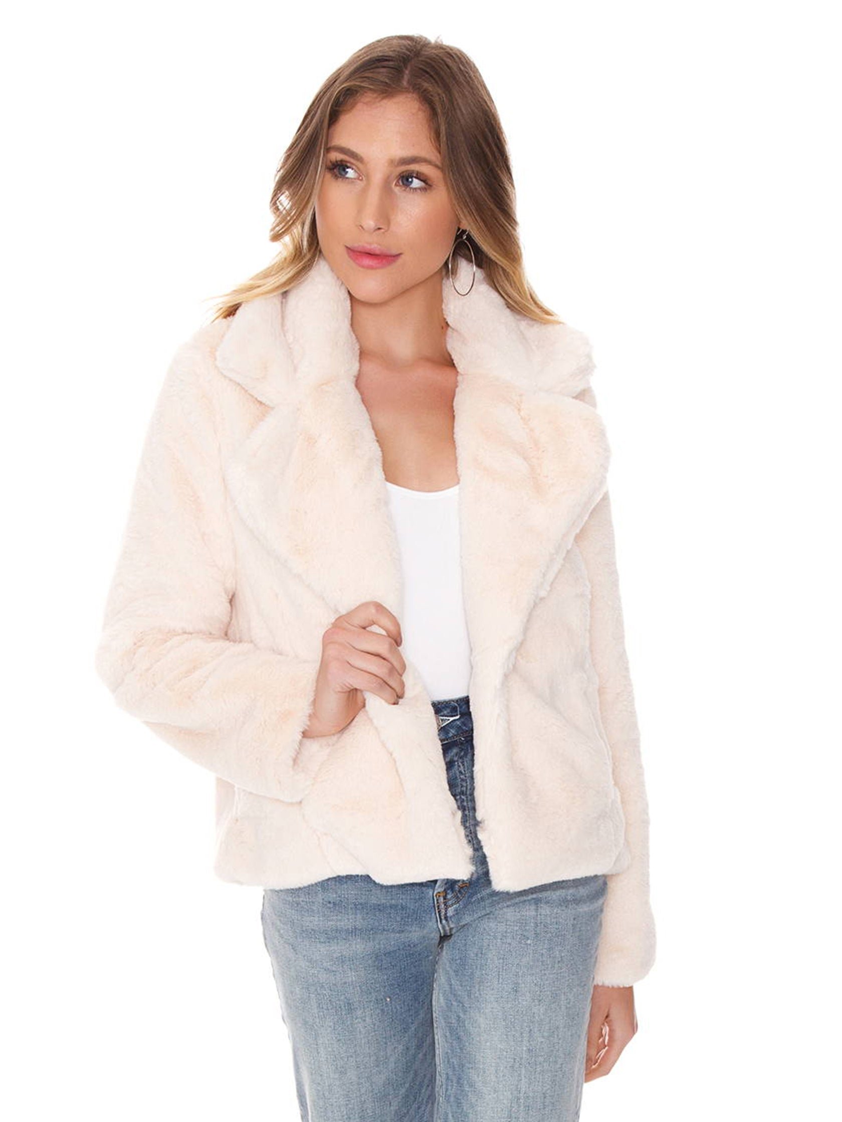 Woman wearing a jacket rental from FashionPass called Izzy Faux Fur Jacket