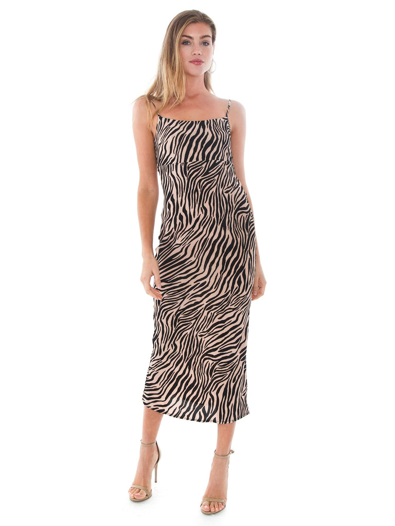 Woman wearing a dress rental from Flynn Skye called Heat Wave Printed Maxi