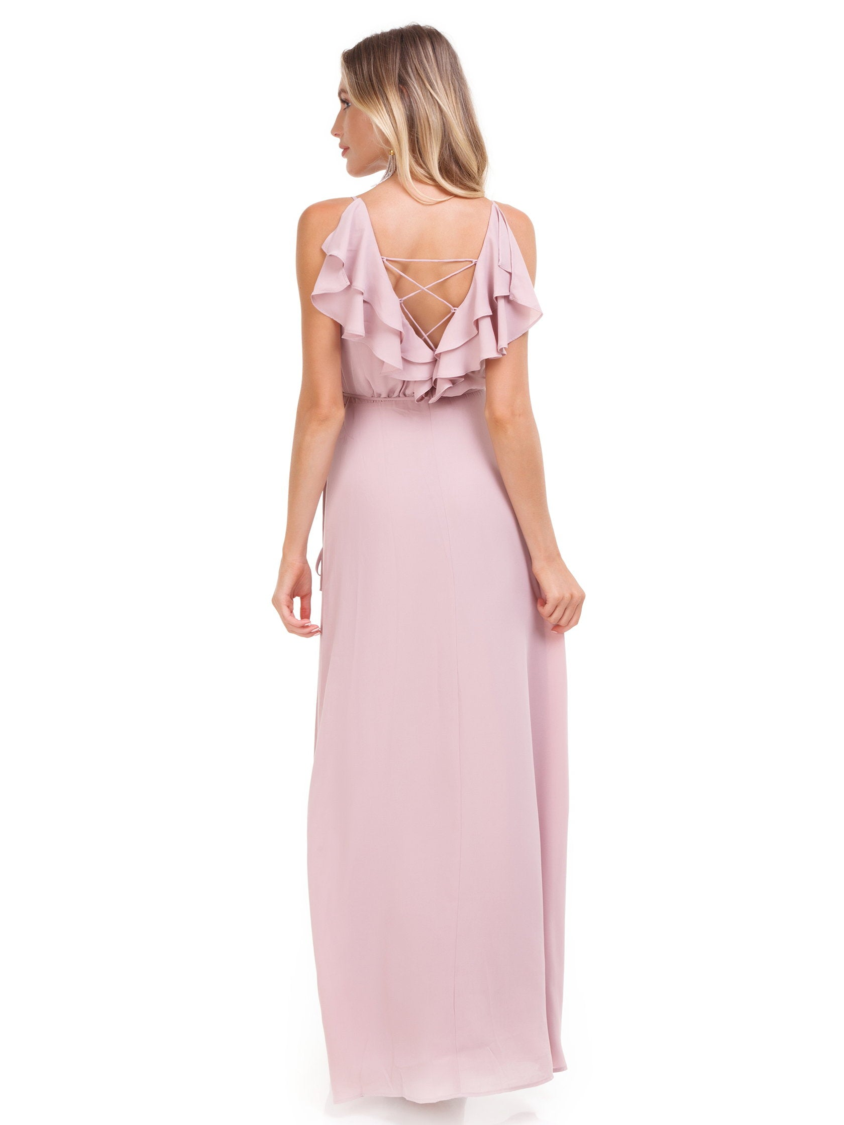 Women wearing a dress rental from WAYF called Jamie Ruffle Wrap Gown