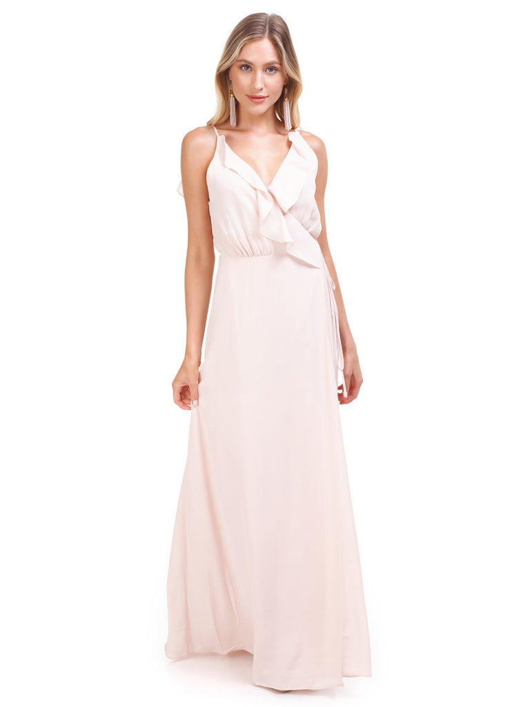 Woman wearing a dress rental from WAYF called Gwyneth Ruffle Maxi Dress