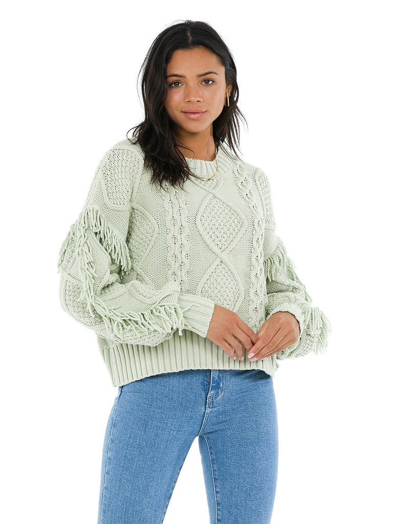 Women wearing a sweater rental from Line & Dot called Jasper Fringe Sweater