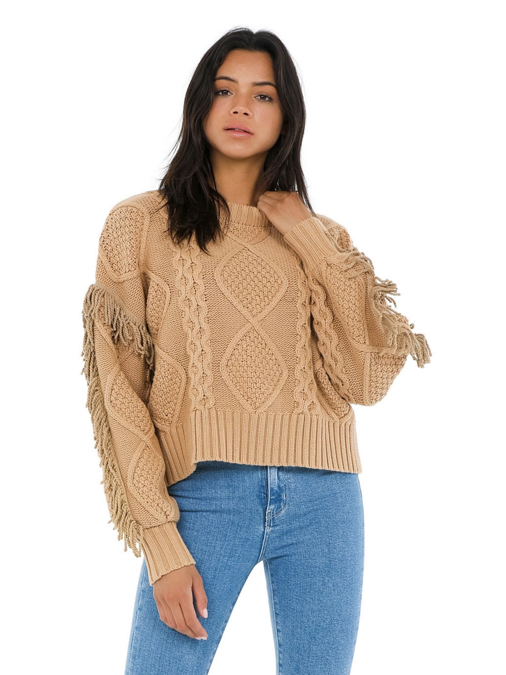 Woman wearing a sweater rental from Line & Dot called Jasper Fringe Sweater