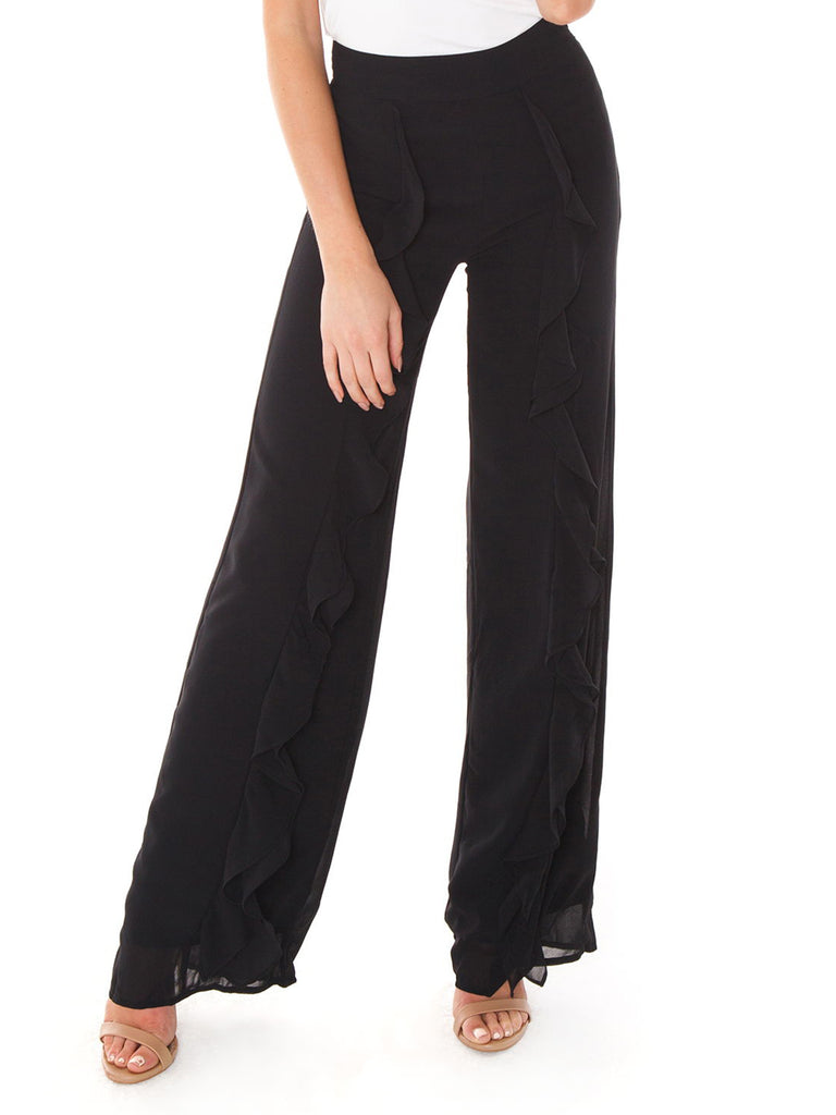 Woman wearing a pants rental from Line & Dot called Campbell High Slit Pants