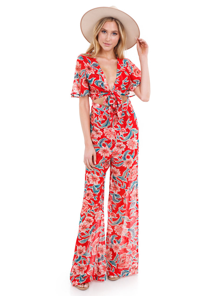 Women wearing a jumpsuit rental from Show Me Your Mumu called Jenna Jumpsuit