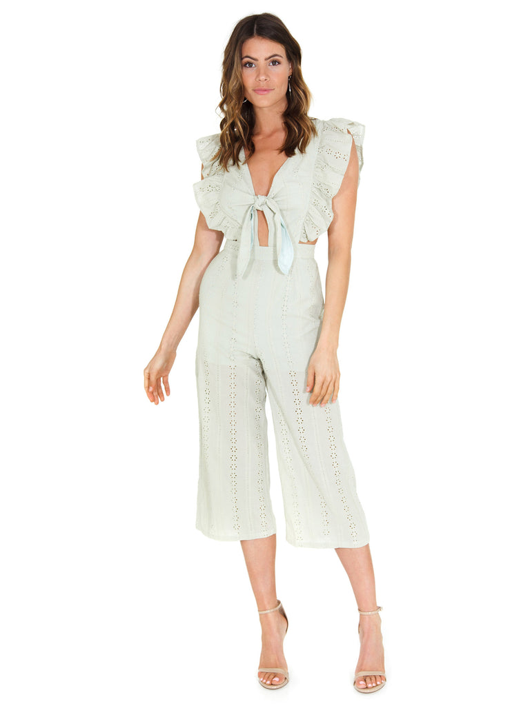 Girl wearing a jumpsuit rental from FashionPass called Eyelet Apron Jumpsuit