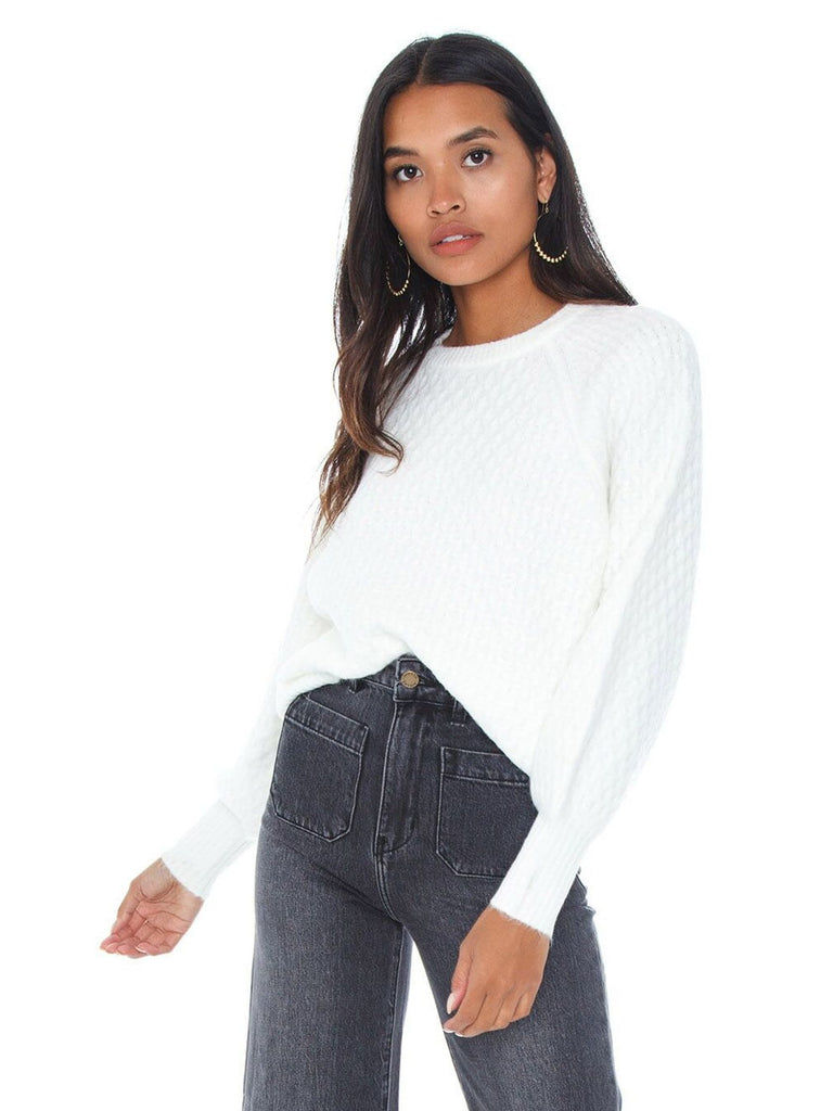 Girl wearing a sweater rental from Line & Dot called Say It To Me Bodysuit