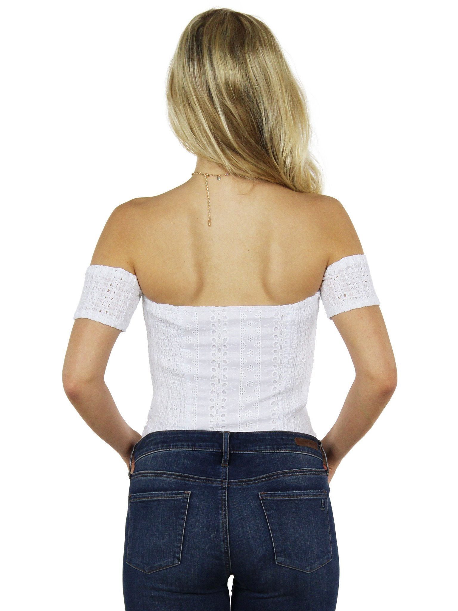 Women wearing a top rental from J.O.A. called Off Shoulder Eyelet Bodysuit