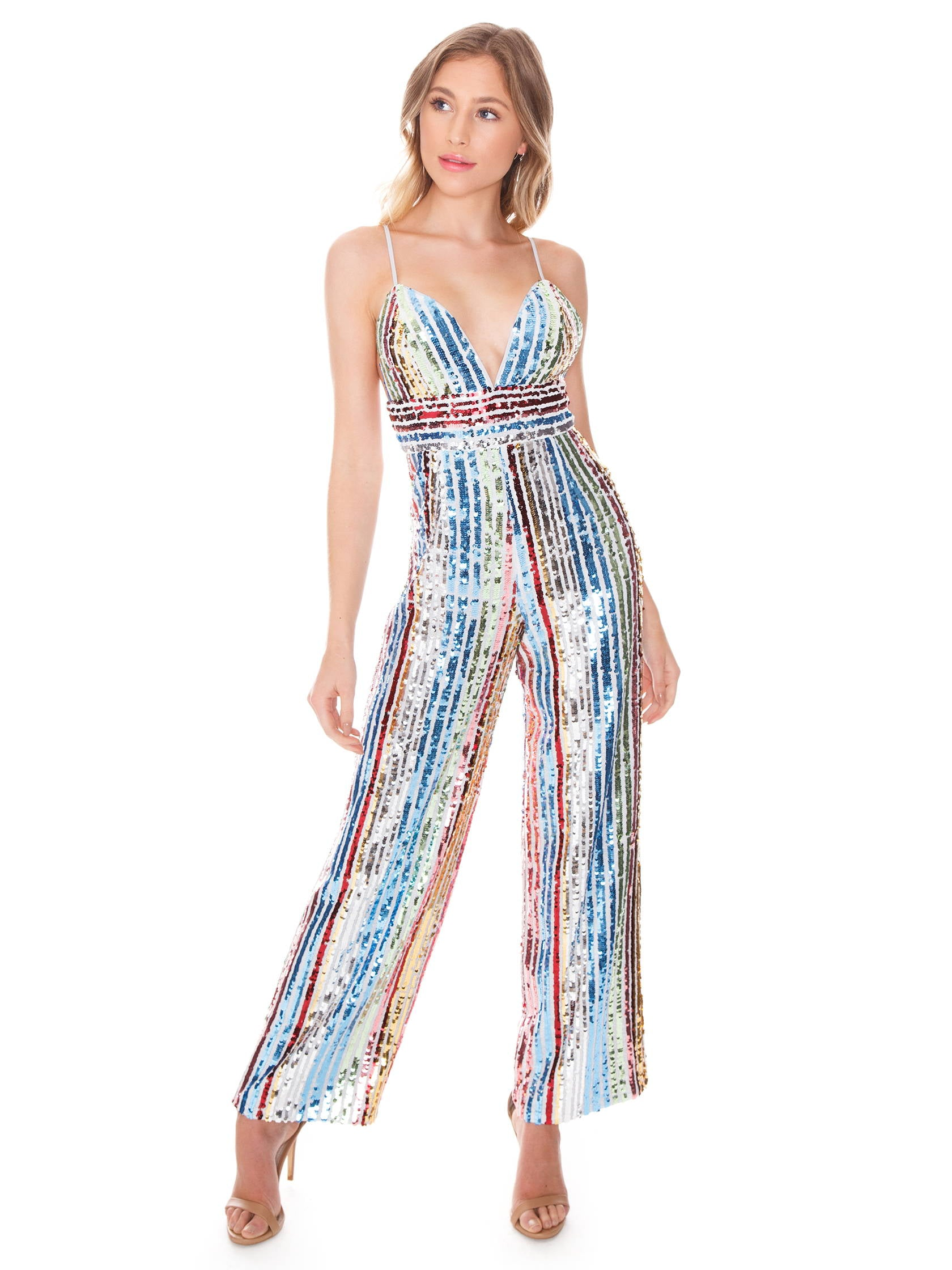 Woman wearing a jumpsuit rental from Saylor called Jojo Jumpsuit