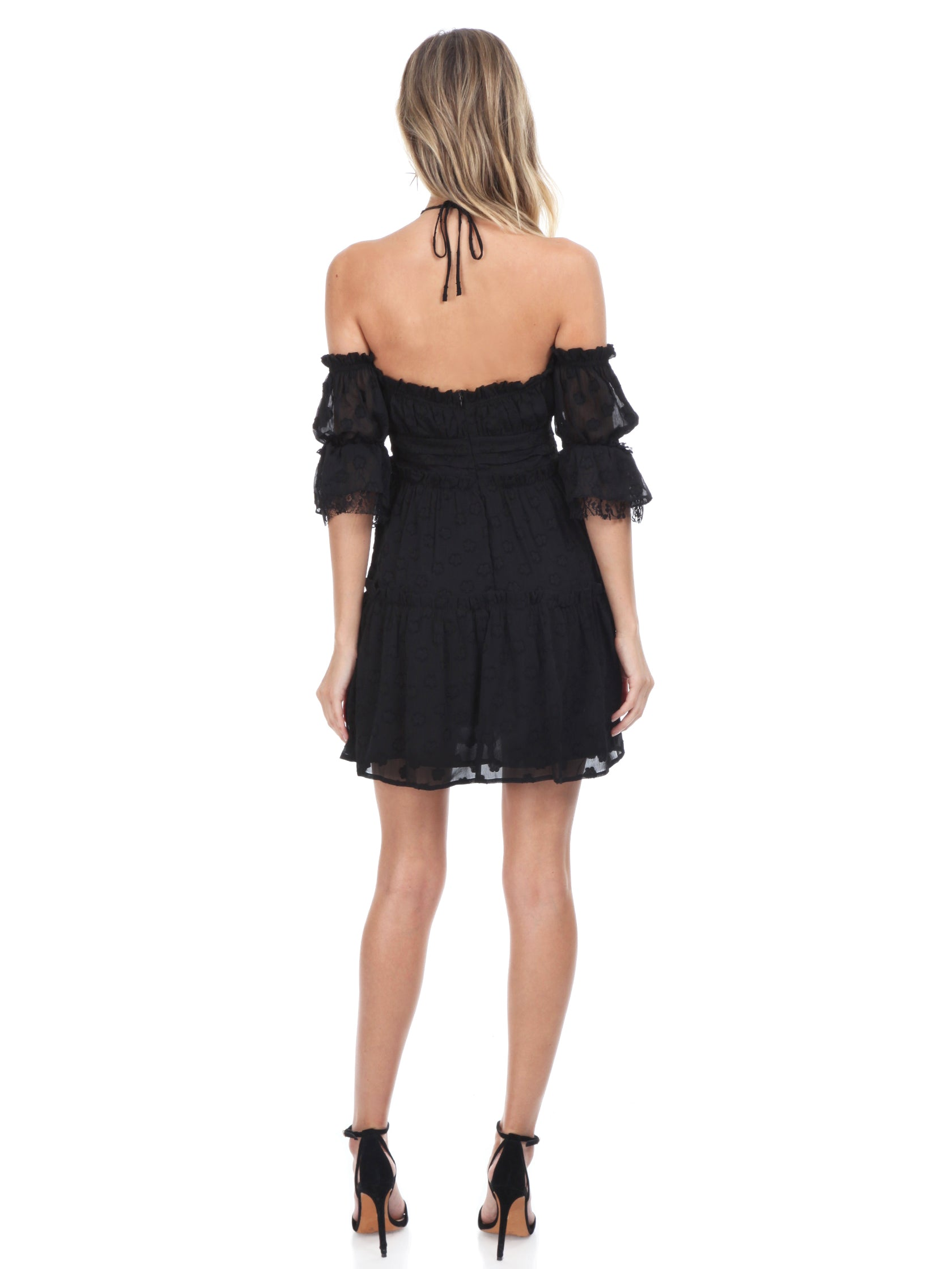 Women wearing a dress rental from FashionPass called Jordan Ruffle Mini Dress