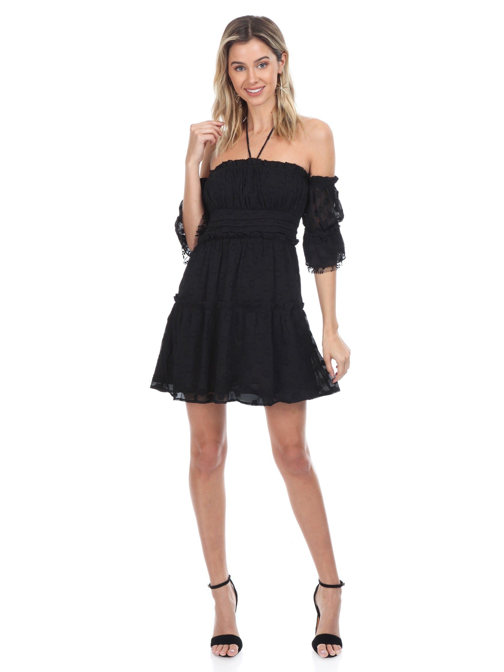 Girl outfit in a dress rental from FashionPass called Jordan Ruffle Mini Dress