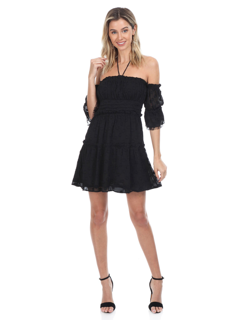 Woman wearing a dress rental from FashionPass called Take Me To Tulum Romper