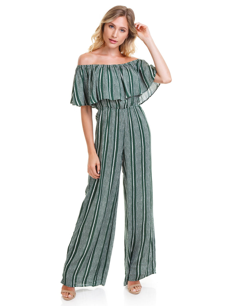 Woman wearing a jumpsuit rental from SAGE THE LABEL called Eyelet Apron Jumpsuit