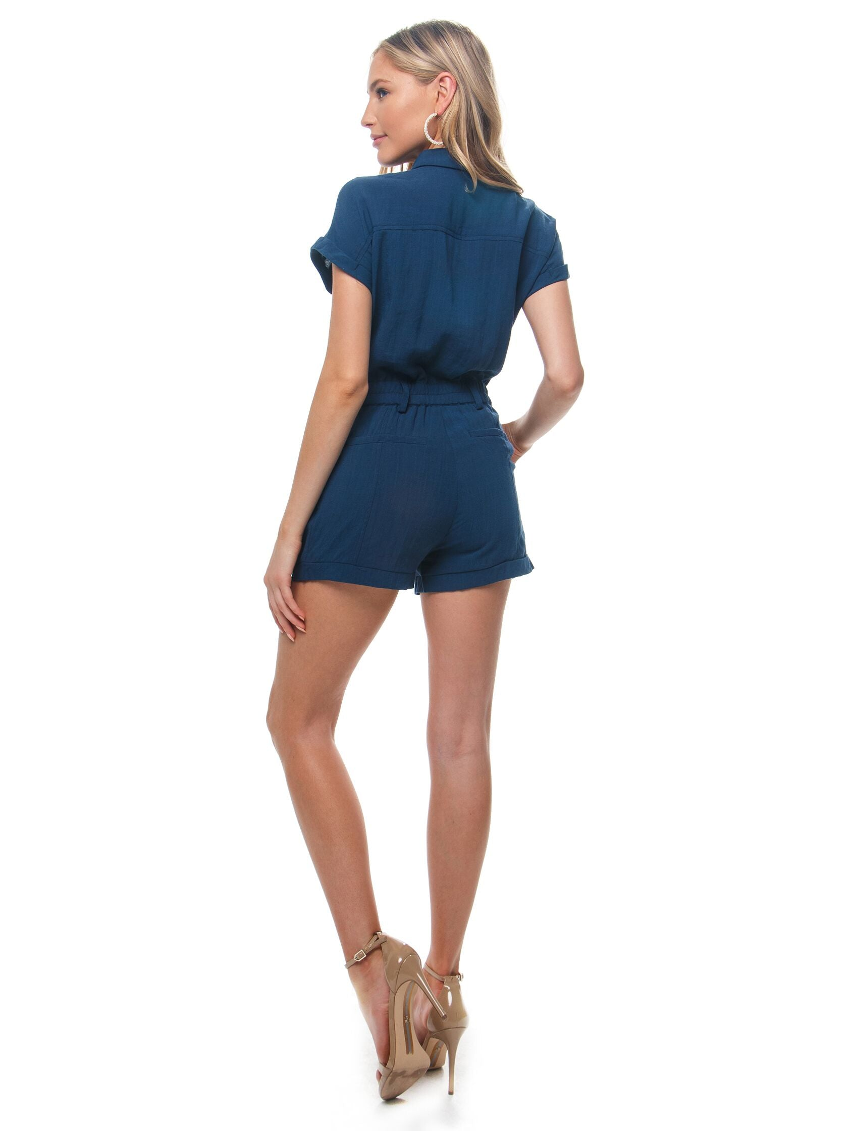 Women wearing a romper rental from Heartloom called Jude Romper