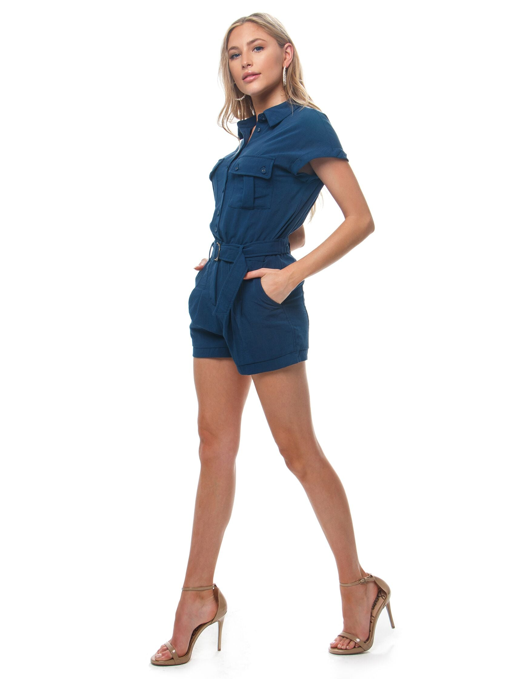 Woman wearing a romper rental from Heartloom called Jude Romper